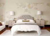 a neutral and cozy bedroom with a floral walls, refined vintage furniture, blush nightstands and table lamps