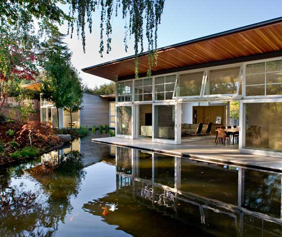 Remodeled House With Large Manmade Pond Near It