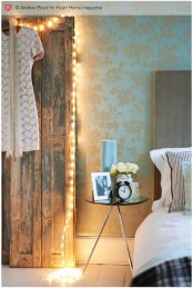 lights covering a vinntage door iwll bring enough illumination and it won't be too obtrusive
