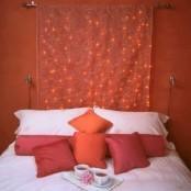 a beautiful embroidered curtain with integrated red lights fits the space decor perfectly