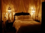 oversized Moroccan hanging lamps over the nightstands is a cool idea for a bedroom
