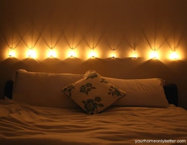 a row of wall lamps over the headboard will brign enough light and will look very stylish
