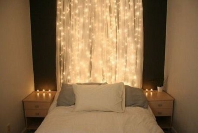 a real sheer curtain with lights instead of a usual headboard for a modern bedroom