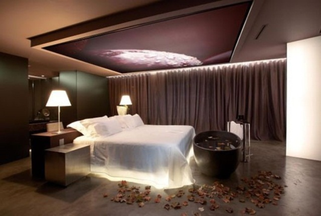 a bed with inner lights and an artwork with lights over the bed