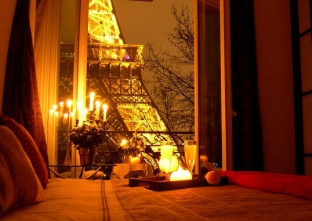 a candelabra and some candle holders look very romantic and cute and the Eiffel Tower adds to it