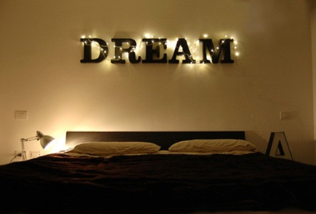 a sign with lights and some table lamps for a chic look