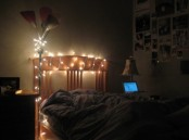 the headboard covered with lights and a floor lamp with lights