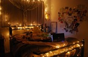 a headboard and a footboard covered with lights plus a large curtain lantern with lights