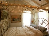 a branch frame with lights over the bed is a cool wy to illuminate the room