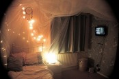 a sheer fabric canopy with lights on it is a cool and easy DIY