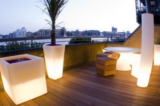 rooftop terrace design ideas glowing outdoor seating and planters are perfect to make your terrace more glam - Rooftop Deck Design Ideas
