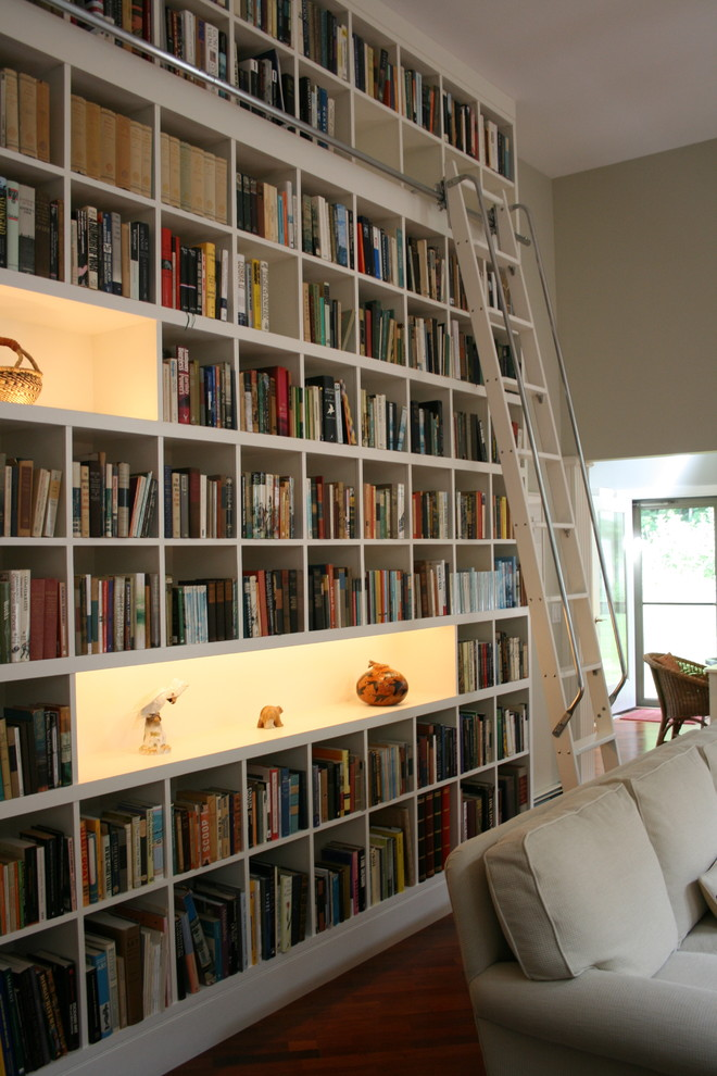 rows of matching billy bookcases from ikea will do the trick if you