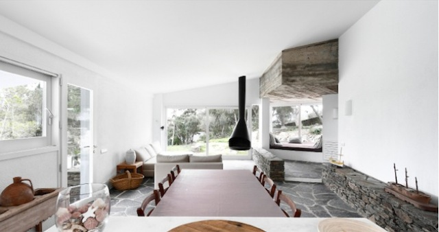 Rustic House With Massive Rock Formations In The Interior