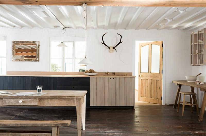 Rustic Kitchen With An Extensive Use Of Rough Wood