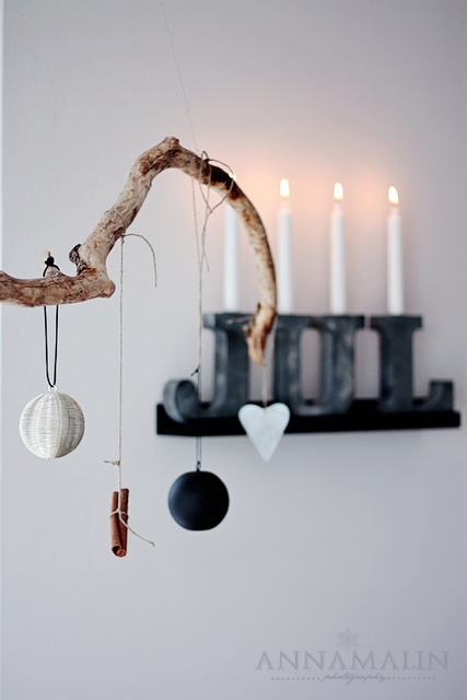 a branch with paper and fabric ornaments and cinnamon sticks is a minimalist and Scandi decoration for Christmas