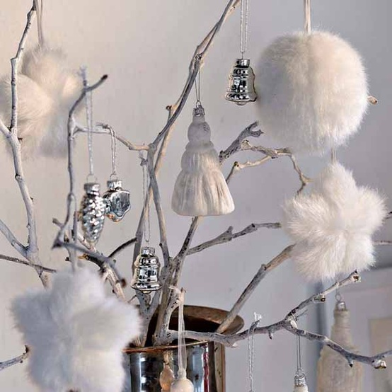 whitewashed branches with white and silver Christmas ornaments, fluffy and metallic ones