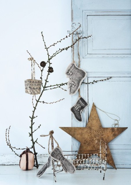 Nordic Christmas decor with branches, plywood stars, stockings, pinecones is simple and natural
