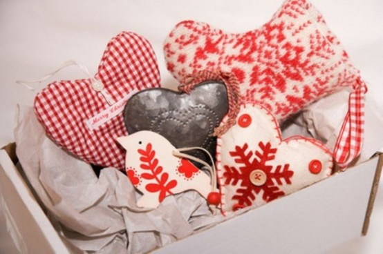 a box with red and white fabric heart Christmas ornaments done in vintage style is a very chic idea