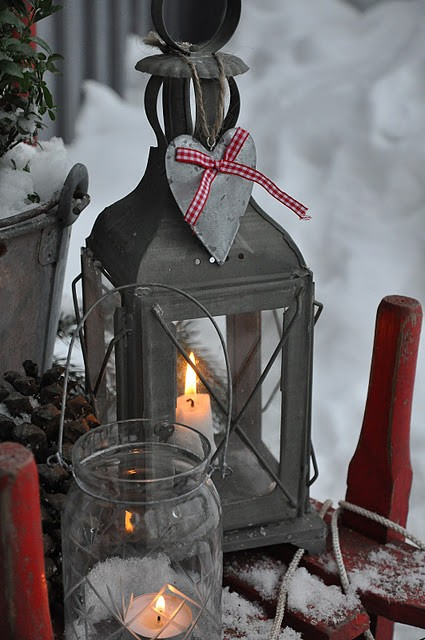 a metal candle lantern with a fabric heart, a glass candle lantern will suit outdoor decor, too