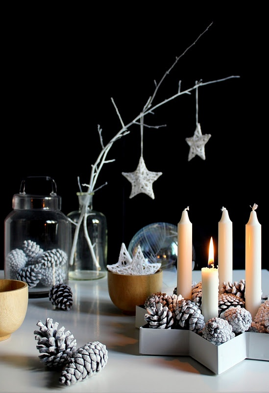 bleached pinecones, candles, whitewashed branches with metallic star ornaments