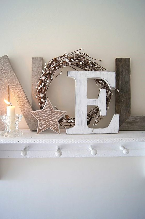wood and plywood NOEL letters, stars, a wreath and a candle in a glass candleholder for a Nordic feel in the space