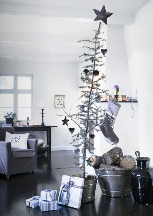 a Christmas tree in a bucket, wooden ornaments and firewood in galvanized buckets for a cozy Nordic feel