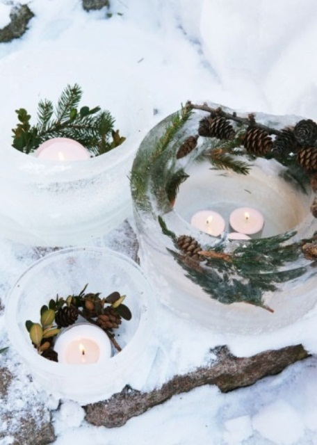 ice bowls with evergreens and pinecones and candles in them for Nordic outdoor decor