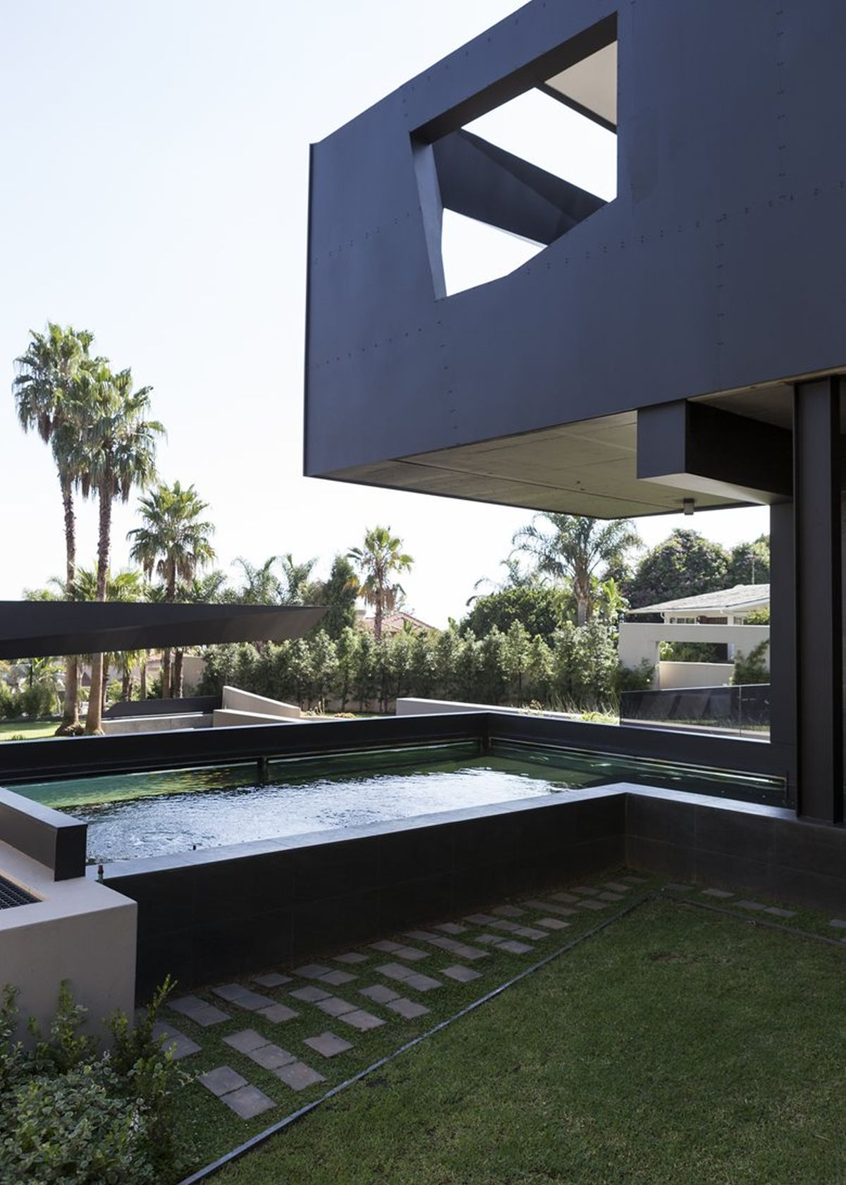Picture Of sculptural family home with minimalist interiors  26
