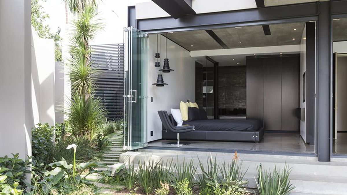 Picture Of sculptural family home with minimalist interiors  27
