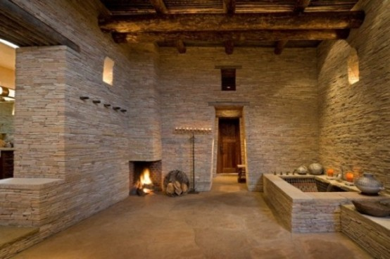 Sculptural Rough Stone Bathroom Design
