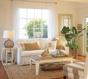 a neutral coastal living room with plenty of texture – rattan, jute, wood, starfish in a dough bowl and potted plants