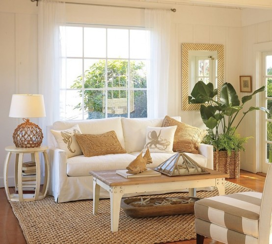a neutral coastal living room with plenty of texture - rattan, jute, wood, starfish in a dough bowl and potted plants