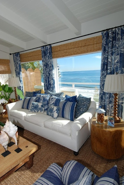 a bright coastal living room in blue and white, with many woven details and touches of jute and wood