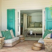 a neutral beach living space with bold turquoise touches and jute and rattan items