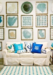 a neutral sofa and a bold gallery wall inspired by sea and sea creatures for a beach living room