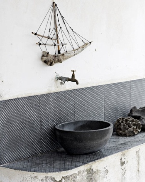 a wabi-sabi bathroom with a shabby chic vanity, black and white tiles, a concrete vessel sink and a branch ship art