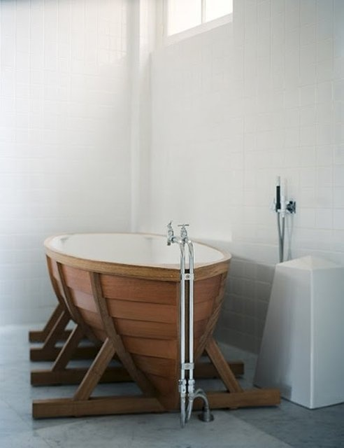a contemporary bathroom in neutrals with a boat-shaped bathtub will increase the ocean-inspired feel in the space