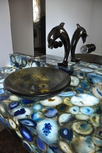 a gorgeous lit up geode vanity inspired by the colors of the sea plus a dolphin fixture