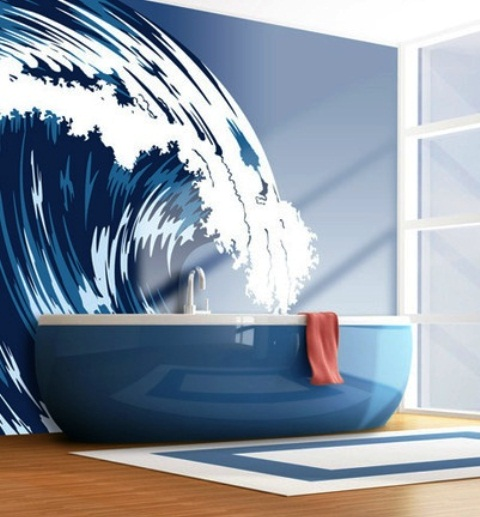a nautical bathroom with a navy bathtub and a gorgeous waves wall mutral for a chic space