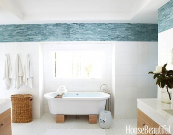 a beachy bathroom with blue and white decor, wooden furniture and baskets for storage