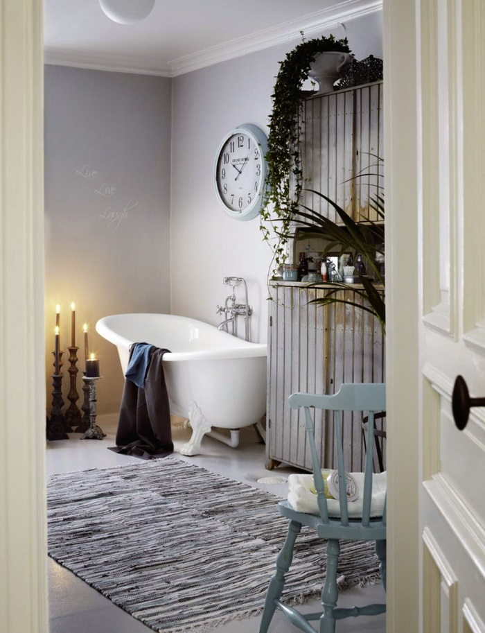 shabby chic bathroom design with a hearth and a sideboard