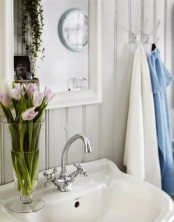 Shabby Chic Bathroom With A Hearth And A Sideboard