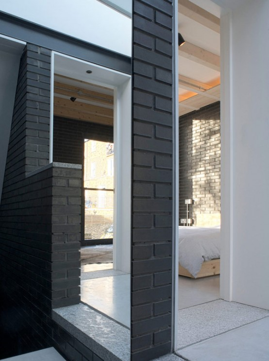 Shadow House Of Black Brick With Industrial Decor