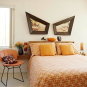 a light-stained wooden bed with attached floating nightstands and an amber leather chair for a warming up mid-century bedroom