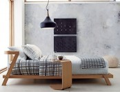 a plywood mid-century modern bed with a matching mini side table is a stylish solution for a cozy bedroom
