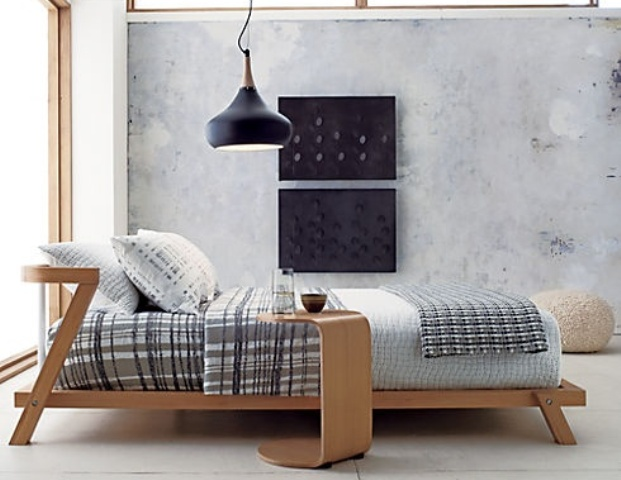 a plywood mid century modern bed with a matching mini side table is a stylish solution for a cozy bedroom