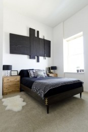 a black wooden mid-century modern bed and light-stained nightstands for a bold mid-century modern bedroom