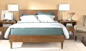 a warm-stained wooden bed and nightstands will be a nice base for a mid-century modern space