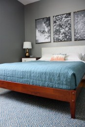 a redwood bed with a white upholstered headboard and white and rich stained wooden nightstands for a chic mid-century modern bedroom