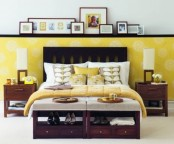 a redwood mid-century modern bed with storage units at the food of the bed and matching nightstands